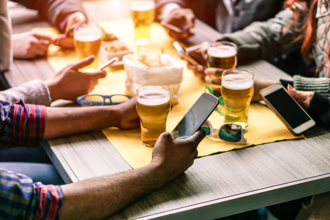 Brewery guests on their phones